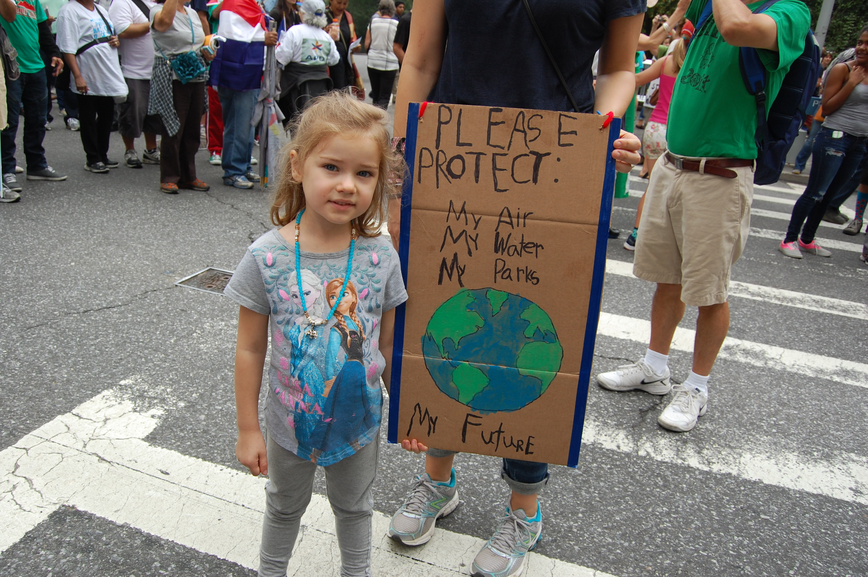 A young marcher and her sign
