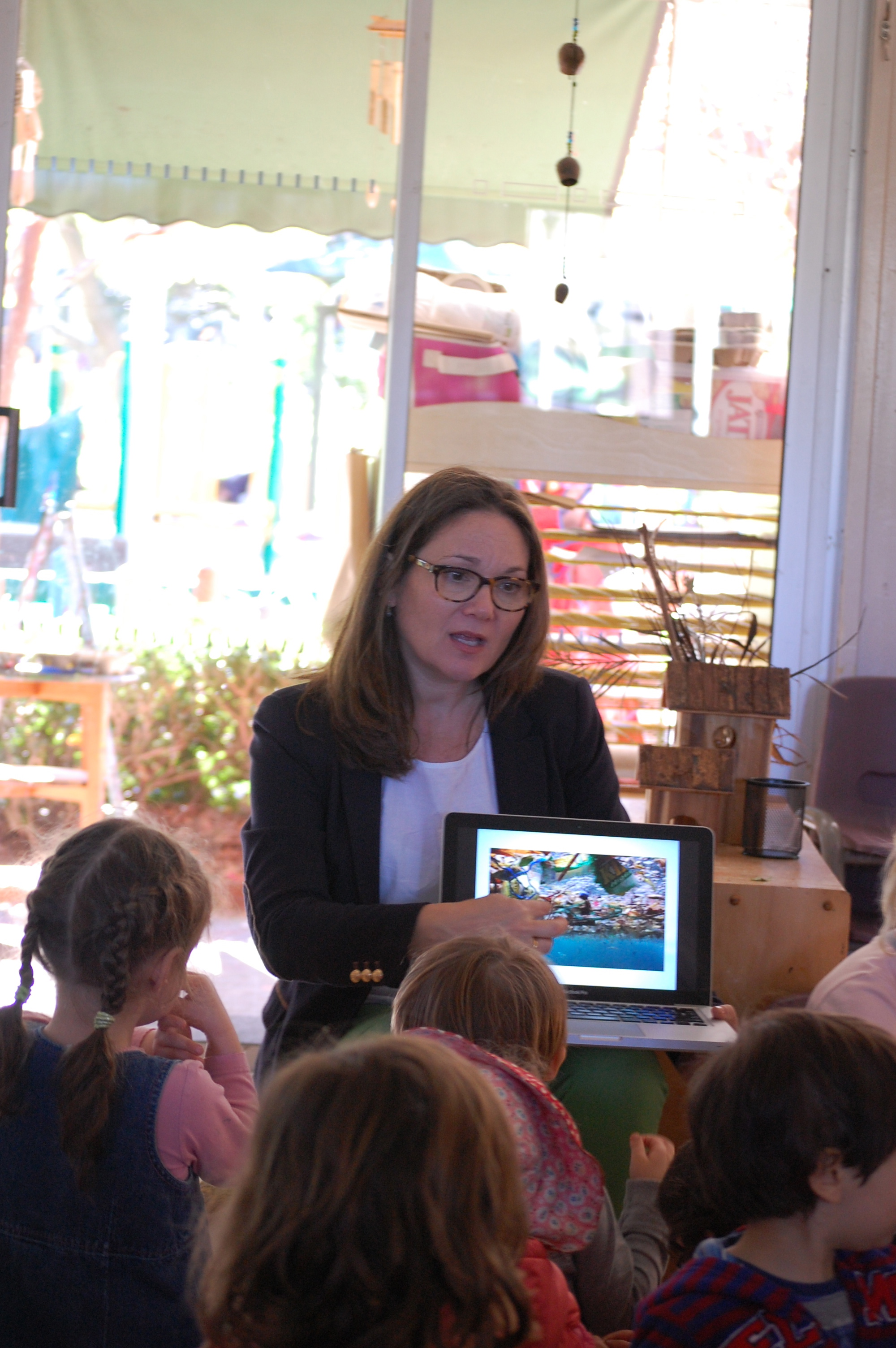 Discussing ocean pollution with a group of Pre-K students